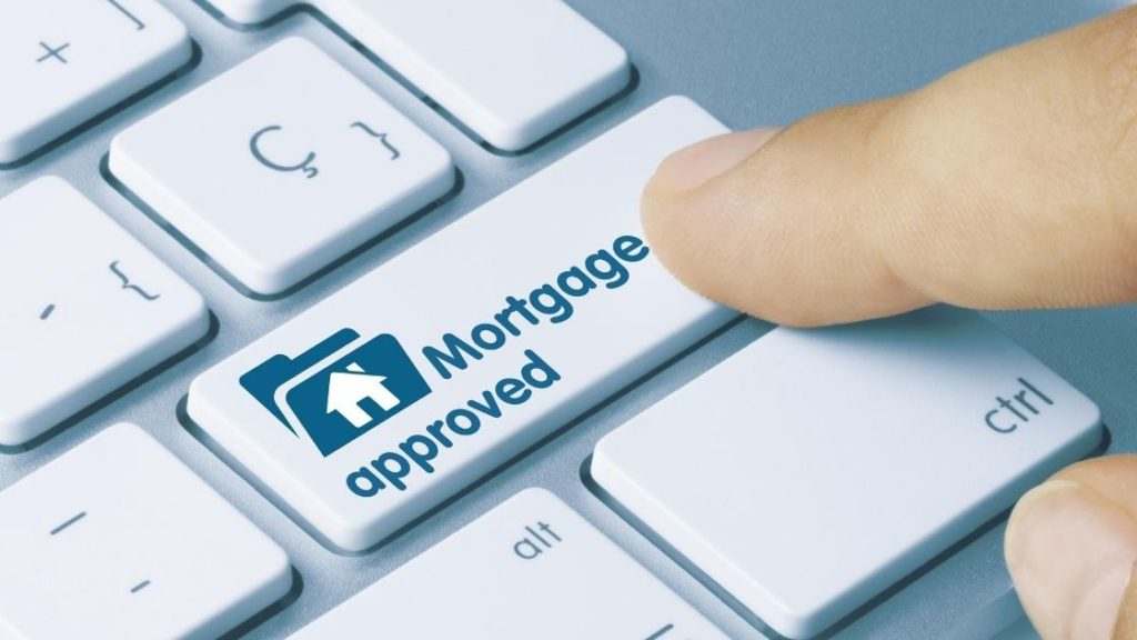 Mortgage Approved button on keyboard being pressed by finger austin asset